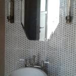 Specchio sagomato stile antico usato nelle masserie salentine restaurate.